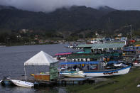 <p>Boats are docked at the reservoir where a ferry sank in Guatape, Colombia, June 25, 2017. (Luis Benavides/AP) </p>