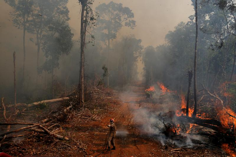 A firefighter from ABAFA Amazonia operation puts out a fire in a forest in the city of Uniao do Sul, in Mato Grosso, Brazil September 4, 2019. REUTERS/Amanda Perobelli