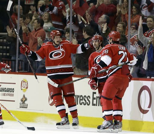 Carolina Hurricanes' Eric Staal (12) celebrates his goal against the Ottawa Senators with Jamie McBain and Alexander Semin (28) during the first period of an NHL hockey game in Raleigh, N.C., Friday, Feb. 1, 2013. (AP Photo/Gerry Broome)