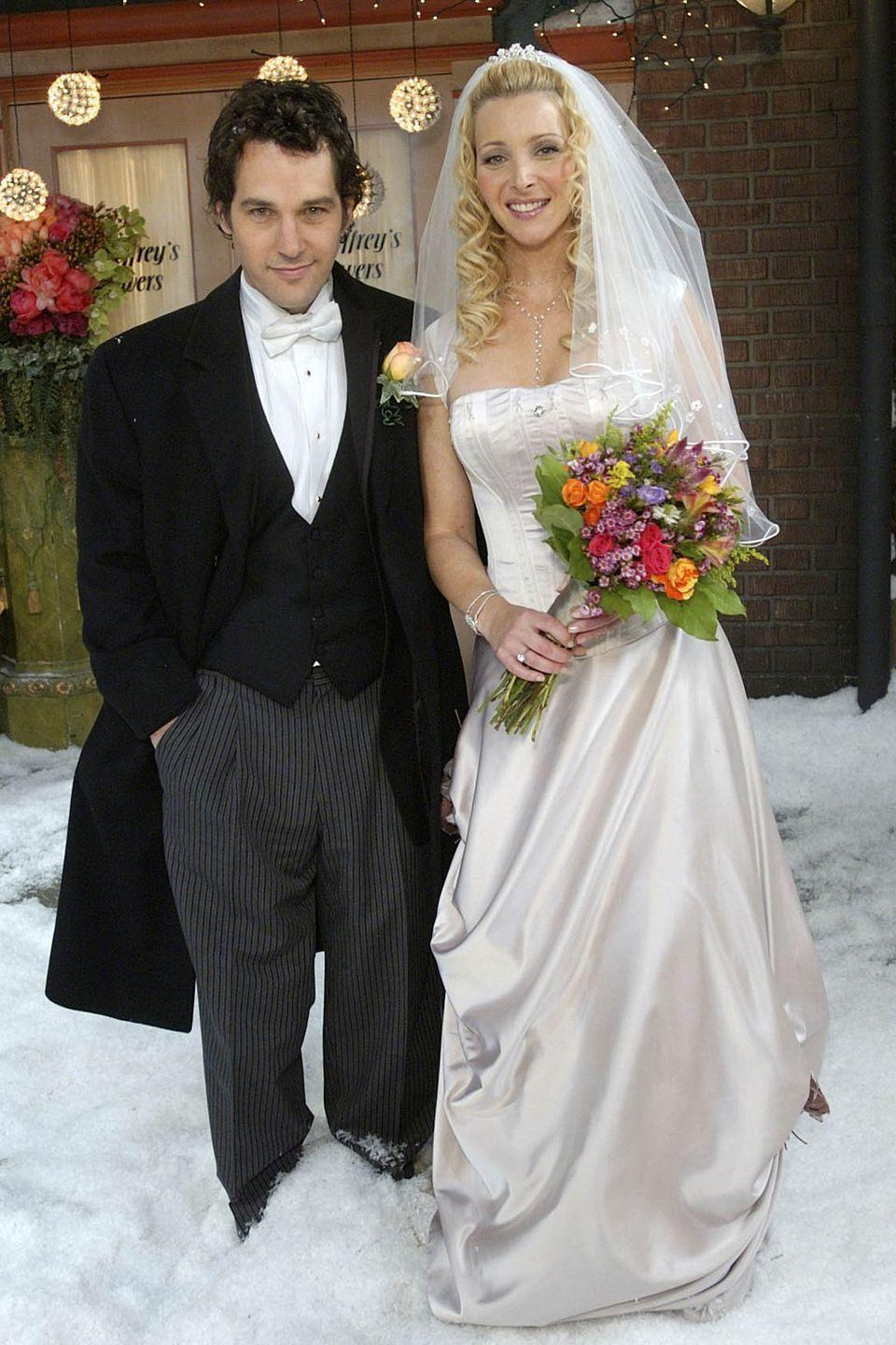 <p>Phoebe and Mike married in season 10, right outside of Central Perk, in the snow. She wore a strapless dress with a fitted bodice and draping in the skirt. </p>