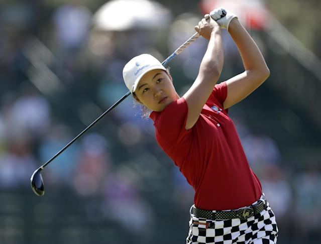 Minjee Lee, of Australia, watches her tee shot on the 13th hole during the second round of the U.S. Women's Open golf tournament in Pinehurst, N.C., Friday, June 20, 2014. (AP Photo/Bob Leverone)