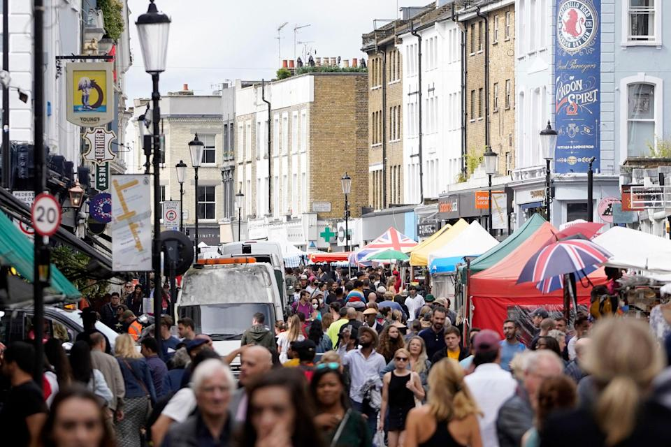 Image: Shoppers on Portobello Road market in London's Notting Hill (Niklas Halle'n / AFP via Getty Images)