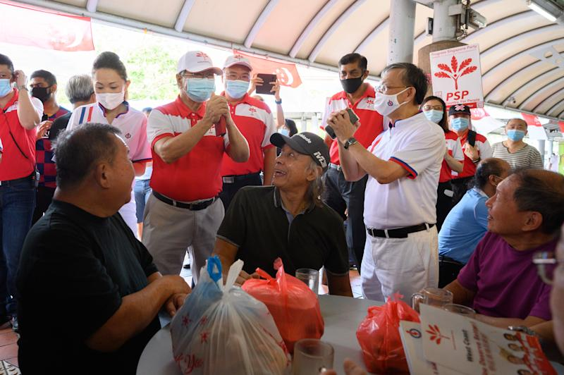 PSP chief Tan Cheng Bock greets a PAP member and residents during a party walkabout on Saturday (4 July). (PHOTO: Joseph Nair for Yahoo News Singapore)