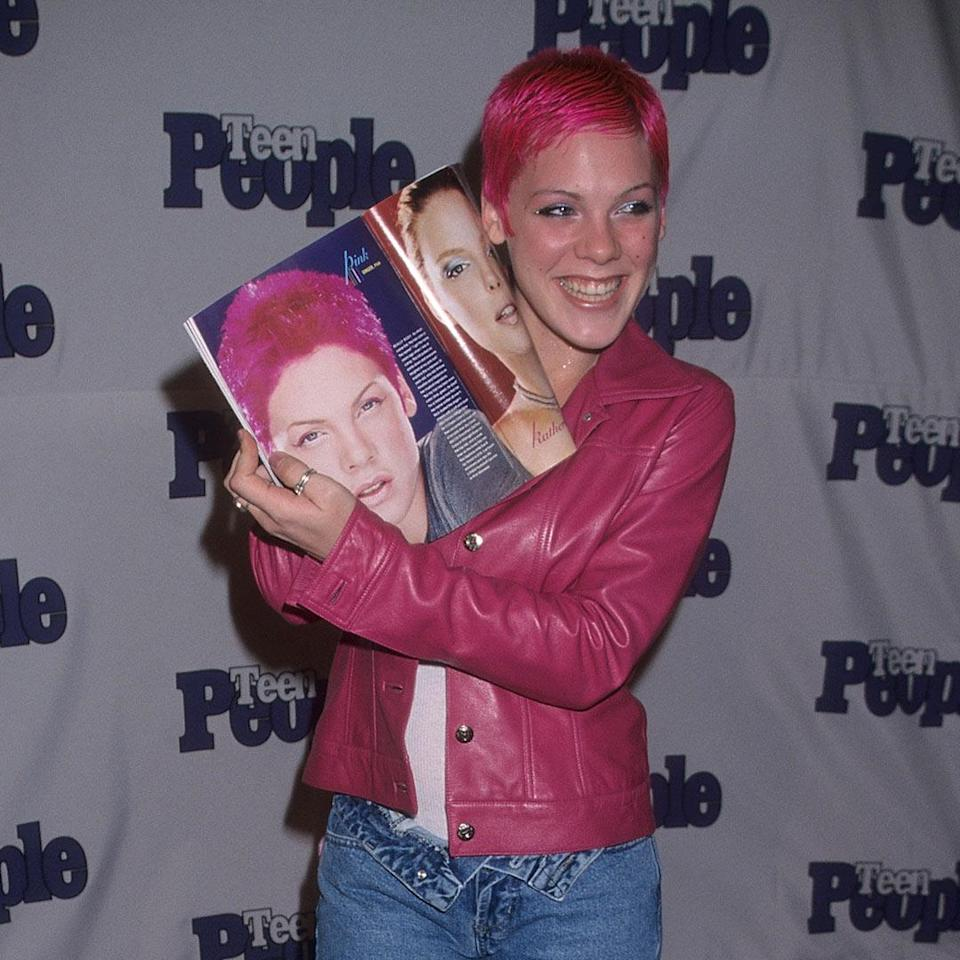 """<p>In 2000, Pink released her first solo record, <em>Can't Take Me Home</em>, and she earned two Top 10 singles: """"There You Go"""" and """"Most Girls."""" Soon after, the singer started opening up for the wildly popular boy band *NSYNC. </p>"""