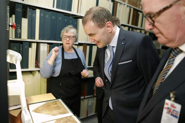 Iceland's President Gudni Johannesson viewed the Arnamagnaean collection during a trip to Denmark in 2017 (AFP Photo/Martin Sylvest)