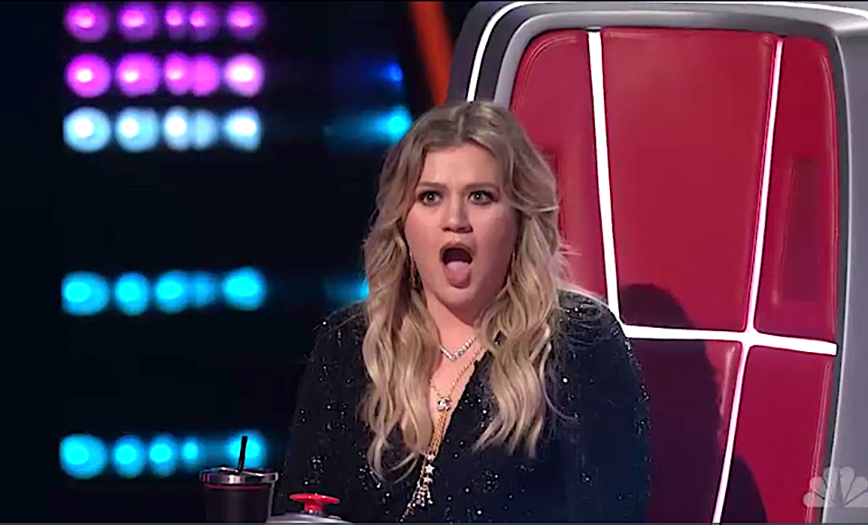 Kelly Clarkson reacts to John Holiday on 'The Voice.' (Photo: NBC)