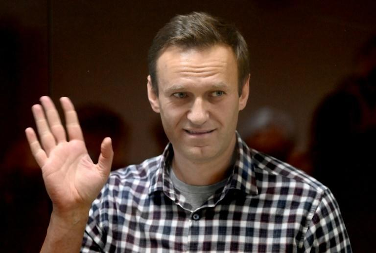 Russian opposition leader Alexei Navalny stands inside a glass cell during a court hearing in Moscow on February 20, 2021
