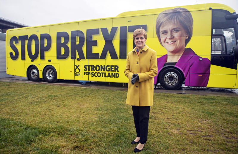 Scottish National Party (SNP) leader Nicola Sturgeon launches the party's election campaign bus, featuring a portrait of herself, at Port Edgar Marina in the town of South Queensferry, Scotland, before setting off on a tour of Scotland for the final week of the SNP's General Election campaign, Thursday Dec. 5, 2019. Britain's Brexit is one of the main issues for all political parties and for voters, as the UK goes to the polls in a General Election on Dec. 12. (Jane Barlow/PA via AP)