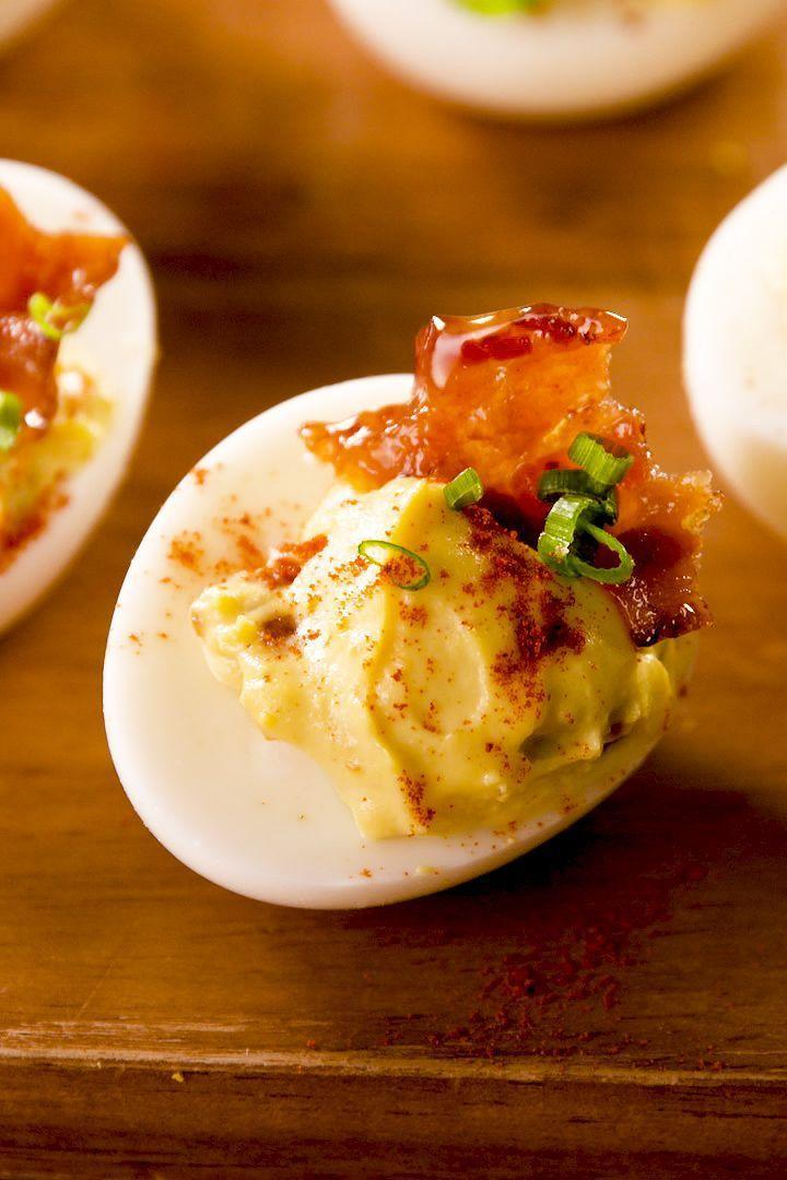 """<p>A little salty and a little sweet, the maple-glazed bacon kick up the traditional bacon deviled egg. </p><p><strong><em>Get the recipe at <a href=""""https://www.delish.com/cooking/recipe-ideas/a26873028/deviled-eggs-with-bacon-recipe/"""" rel=""""nofollow noopener"""" target=""""_blank"""" data-ylk=""""slk:Delish"""" class=""""link rapid-noclick-resp"""">Delish</a>. </em></strong></p>"""