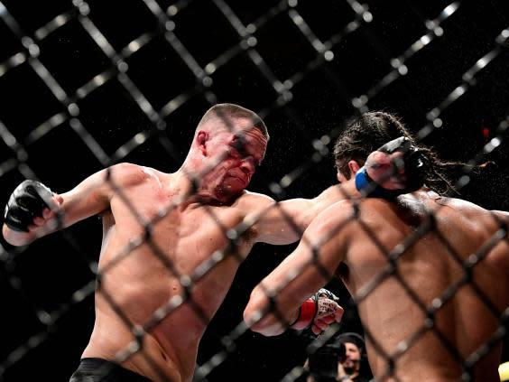 Diaz and Masvidal battle at UFC 244 (Getty)