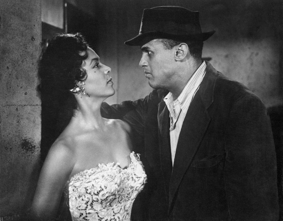 <p>The peak of Dandridge's career was earning the starring role in Otto Preminger's musical <em>Carmen Jones</em>. Here, the actress films a scene for the movie with her costar, Harry Belafonte. </p>
