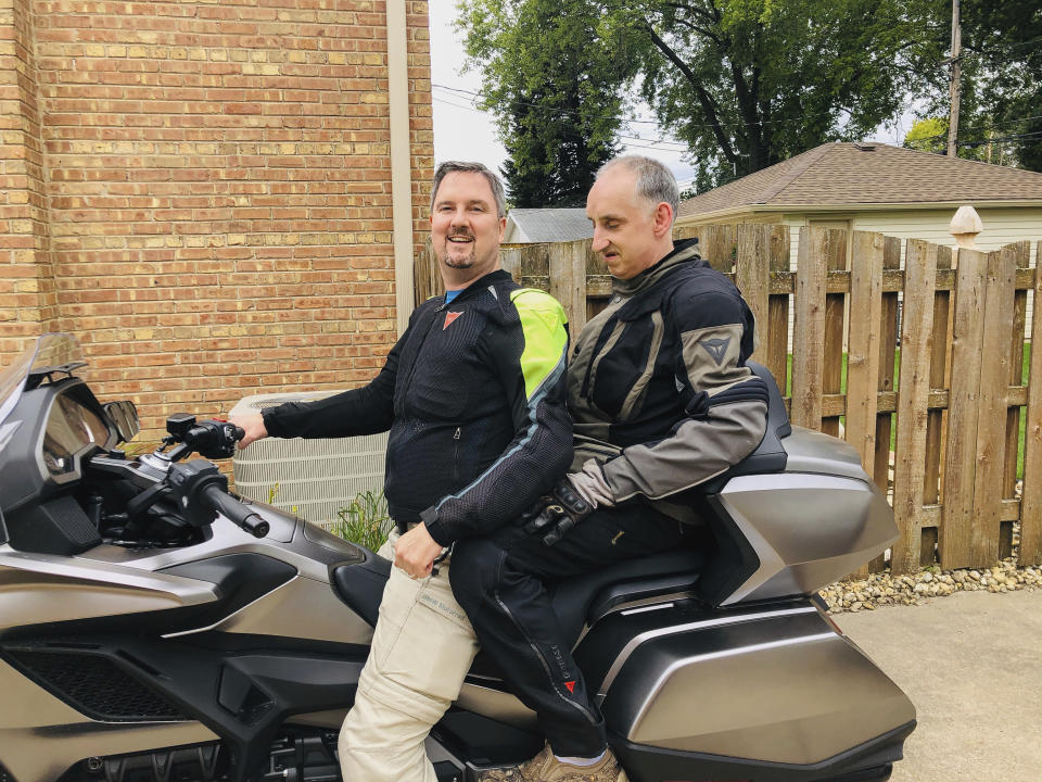 This 2019 photo provided by the family shows Joe Sullivan, right, of the Chicago-area, with his brother, Neil. When COVID-19 began spreading across the country, Neil prayed it wouldn't hit Elisabeth Ludeman Developmental Center _ where 346 people live in 40 ranch-style homes spread across a campus that resembles an apartment complex. If it did, he knew his brother and others there would be in danger. (Family photo via AP)