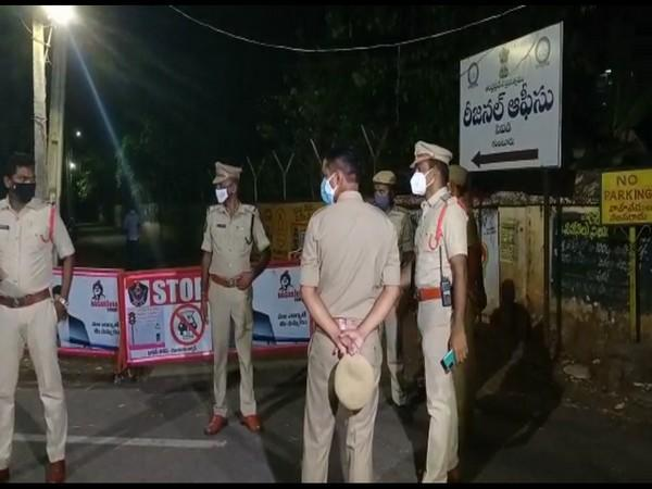 Police personnel around the CID office in Guntur where the YSRCP member was taken. (Photo/ANI)