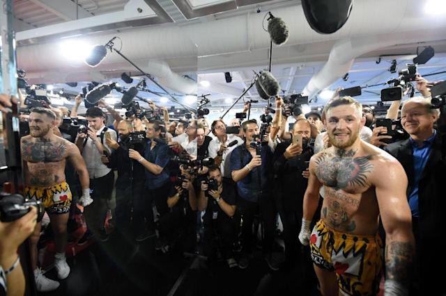 Conor McGregor may not defeat Floyd Mayweather, but one thing he won't do is wilt in the spotlight. (Getty Images)