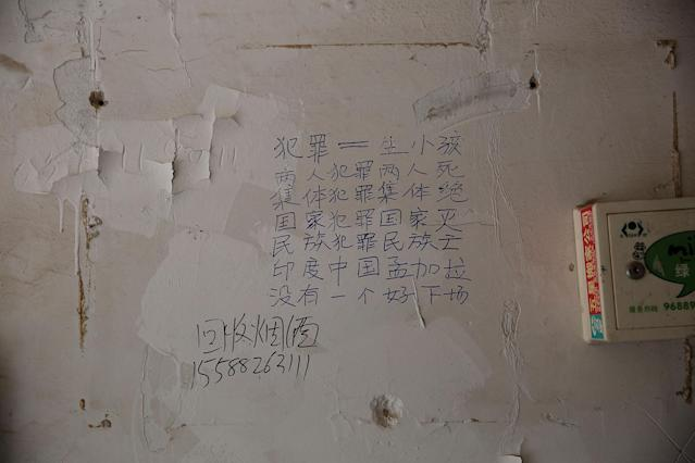 "<p>Chinese characters reading ""crime equals to giving birth, two people crime, two people die, group crime, group die, country crimes, country dies, ethnic crimes, ethnic dies, India China Bangladesh, none will have a good end"" are seen on a wall inside a residential building next to the scene of an explosion inside a kindergarten in Fengxian County of Xuzhou in Jiangsu Province, China, June 16, 2017. (Photo: Aly Song/Reuters) </p>"