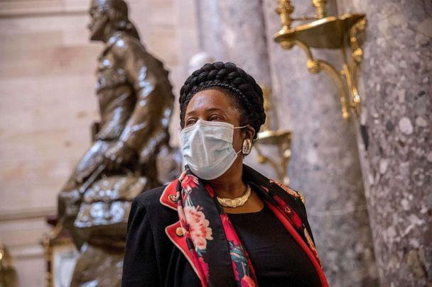 PHOTO: Rep. Sheila Jackson Lee wears a mask and speaks to a reporter as she walks towards the House Chamber on Capitol Hill, April 23, 2020, in Washington. (Andrew Harnik/AP)