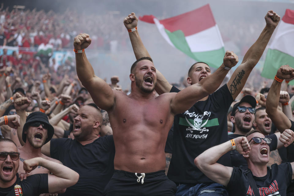 Hungarian fans celebrate after Attila Fiola scored his side's opening goal, during the Euro 2020 soccer championship group F match between Hungary and France, at the Ferenc Puskas stadium in Budapest, Saturday, June 19, 2021. (Alex Pantling, Pool via AP)