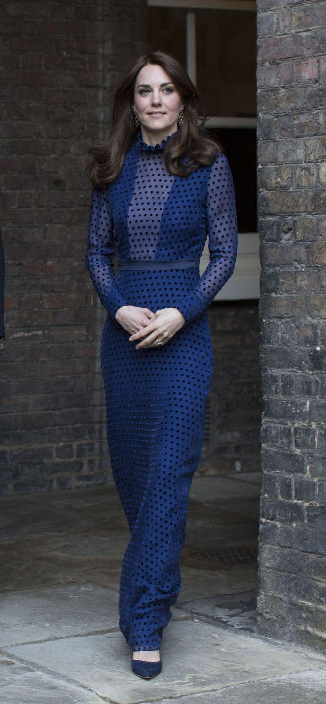 <p>The Duchess of Cambridge attended a reception ahead of their tour of India and Bhutan at Kensington Palace in a navy high-collared and polka dot ensemble. </p>
