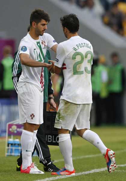 Portugal's Nelson Oliveira, left, replaces Helder Postiga during the Euro 2012 soccer championship Group B match between Denmark and Portugal in Lviv, Ukraine, Wednesday, June 13, 2012. (AP Photo/Armando Franca)