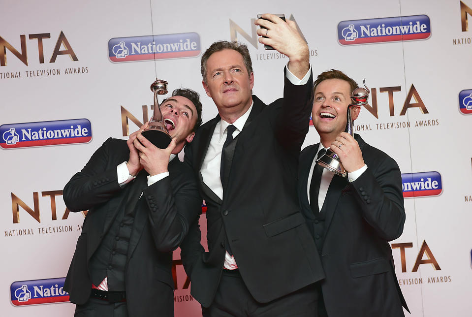 Piers Morgan takes a selfie with Anthony McPartlin and Declan Donnelly winners of the award for Best TV Presenters in the press room at the National Television Awards 2016 held at The O2 Arena in London. PRESS ASSOCIATION Photo. Picture date: Wednesday January 20, 2016. Photo credit should read: Ian West/PA Wire