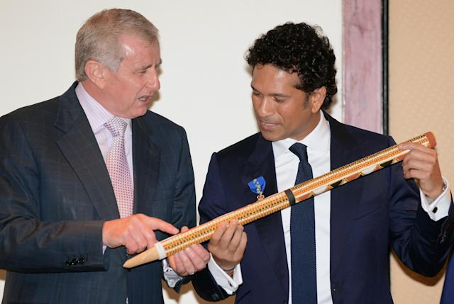 "Simon Crean (L), Australian Minister for Regional Australia, Regional Development and Local Government, gestures at a stump decorated by an aboriginal artist after presenting the membership of The Order of Australia to Indian cricketer Tendulkar in Mumbai on November 6, 2012. India's record-breaking batsman Sachin Tendulkar on November 6 was conferred with membership of the Order of Australia. Australian Prime Minister Julia Gillard, who announced Tendulkar's membership to the Order during a three-day state visit to India last month, told reporters that Tendulkar deserved the ""special honour"" because he was a ""very special cricketer"". AFP PHOTO/ INDRANIL MUKHERJEE"
