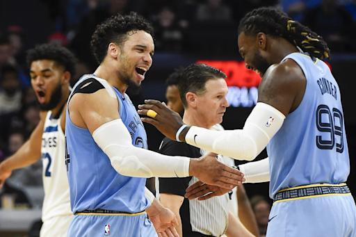 Memphis Grizzlies guard Dillon Brooks, left, celebrates with forward Jae Crowder after drawing a foul by the Minnesota Timberwolves during the second half of an NBA basketball game Sunday, Dec. 1, 2019, in Minneapolis. (AP Photo/Craig Lassig)