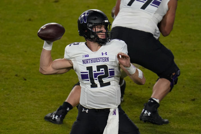 Northwestern quarterback Peyton Ramsey (12) throws against Purdue during the first half of an NCAA college football game in West Lafayette, Ind., Saturday, Nov. 14, 2020. (AP Photo/Michael Conroy)