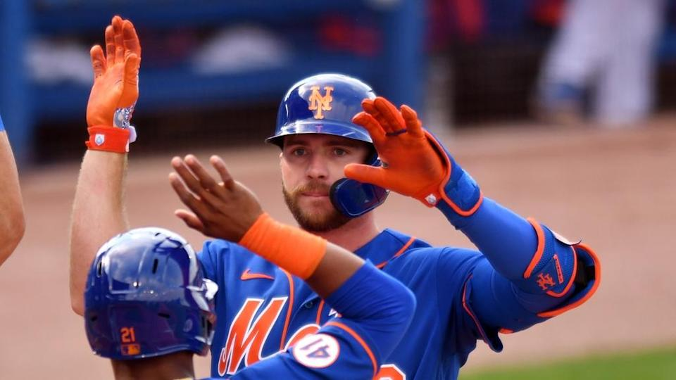 Pete Alonso greeted at home plate after hitting homer in spring training 2021