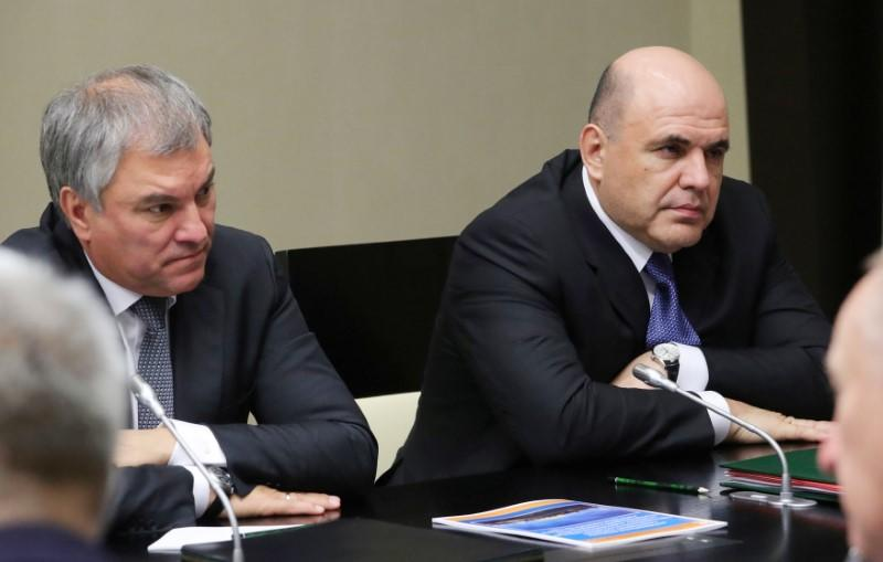 Russian Prime Minister Mikhail Mishustin and Speaker of the State Duma Vyacheslav Volodin attend a meeting with members of the Security Council at the Novo-Ogaryovo state residence outside Moscow