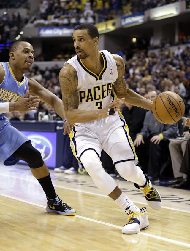 Indiana Pacers guard George Hill, right, drives on Denver Nuggets guard Randy Foye in the second half of an NBA basketball game in Indianapolis, Monday, Feb. 10, 2014. The Pacers won 119-80. (AP Photo/Michael Conroy)