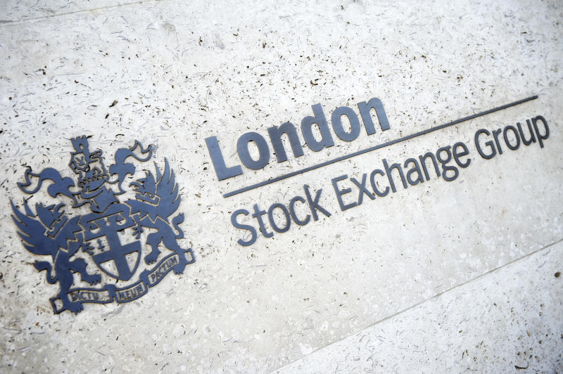 """""""London, UK - April 15, 2012: London Stock Exchange Group sign shines golden on neutral stone wall. The group owns the London Stock Exchange as well as the Borsa Italiana."""""""