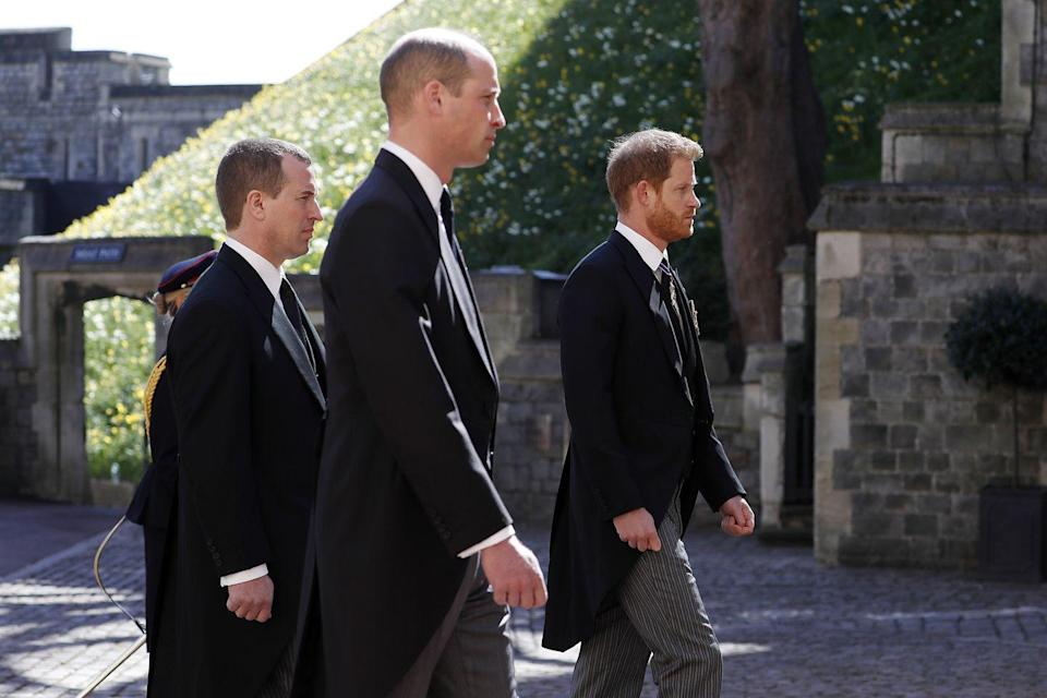 """<p>Prince Harry traveled from California to attend Prince Philip's funeral, though he did not walk directly alongside Prince William. Their cousin Peter Phillips walked between them. </p><p><a class=""""link rapid-noclick-resp"""" href=""""https://www.townandcountrymag.com/society/tradition/a36084551/prince-harry-meghan-markle-prince-philip-funeral-plans/"""" rel=""""nofollow noopener"""" target=""""_blank"""" data-ylk=""""slk:Why Meghan wasn't in attendance."""">Why Meghan wasn't in attendance.</a></p>"""