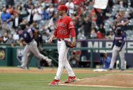Los Angeles Angels starting pitcher Matt Harvey walks off the mound after giving up a three-run home run to Minnesota Twins' Jonathan Schoop, background left, during the second inning of a baseball game Thursday, May 23, 2019, in Anaheim, Calif. (AP Photo/Marcio Jose Sanchez)