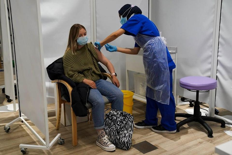 A person receives a Covid-19 jab at a pop-up vaccination centre at Westfield Stratford City (Kirsty O'Connor/PA) (PA Wire)