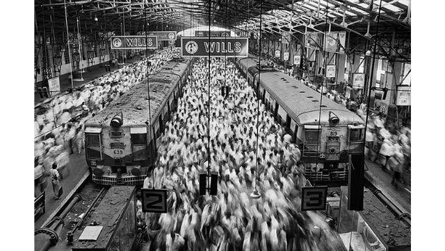 From Sebastiāo Salgado's Exodus. Church Gate railway station. Mumbai, India, 1995.