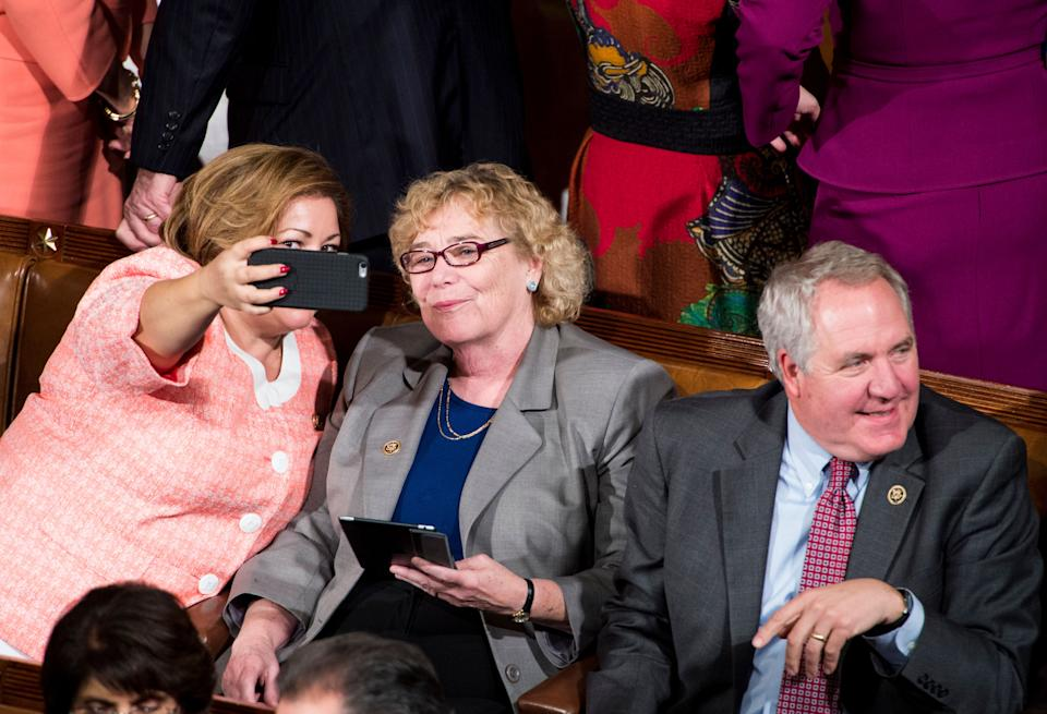 Rep. Linda Sanchez (D-Calif.) takes a selfie with Rep. Zoe Lofgren (D-Calif.) as Rep. John Shimkus (R-Ill.) sits nearby before President Barack Obama's State of the Union address on Jan. 20, 2015.
