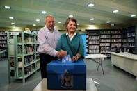FILE PHOTO: Avigdor Lieberman, leader of Yisrael Beitenu party, casts his ballot in Israel's parliamentary election, along with his wife Ella at a polling station in the Israeli settlement of Nokdim in the occupied West Bank