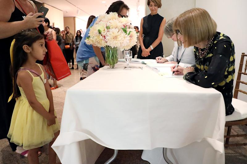 Wintour greets a young patron of the Met