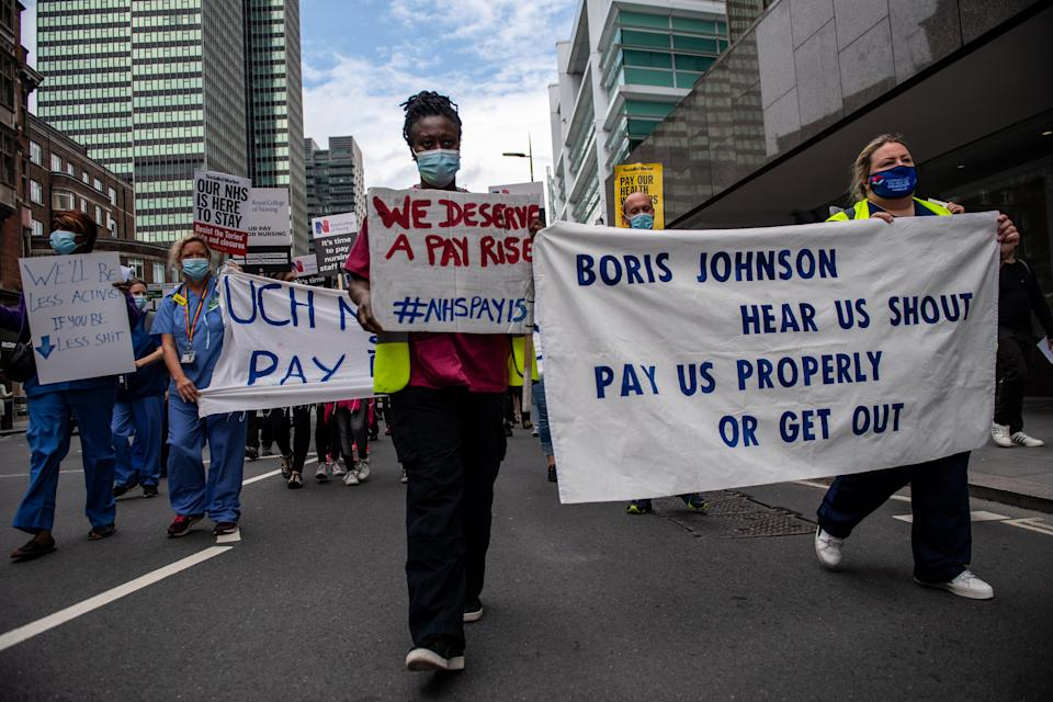 NHS staff taking part in a march through central London demanding a pay rise on the 73rd birthday of its founding on July 3 (Getty Images)