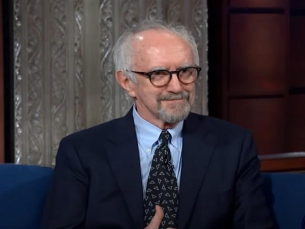 A still from a late night talk show featuring actor Jonathan Pryce (Image source: YouTube)