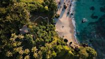 """<p>Sumba Island is twice the size of Bali, and though only an hour's flight away, it still remains undiscovered by mass tourism. The private estate of <a href=""""http://nihi.com"""" rel=""""nofollow noopener"""" target=""""_blank"""" data-ylk=""""slk:Nihi Sumba"""" class=""""link rapid-noclick-resp"""">Nihi Sumba</a> perches on the south-west coast, shrouded by acres of tropical forest and sweeping valleys. For an adventure, opt for the Villa Rahasia experience, which begins with a sunrise trek across the west coast and through rice paddies to the secluded Nihi Oka Valley, where a bush-cooked breakfast awaits you in a treehouse overlooking the Indian Ocean.</p>"""