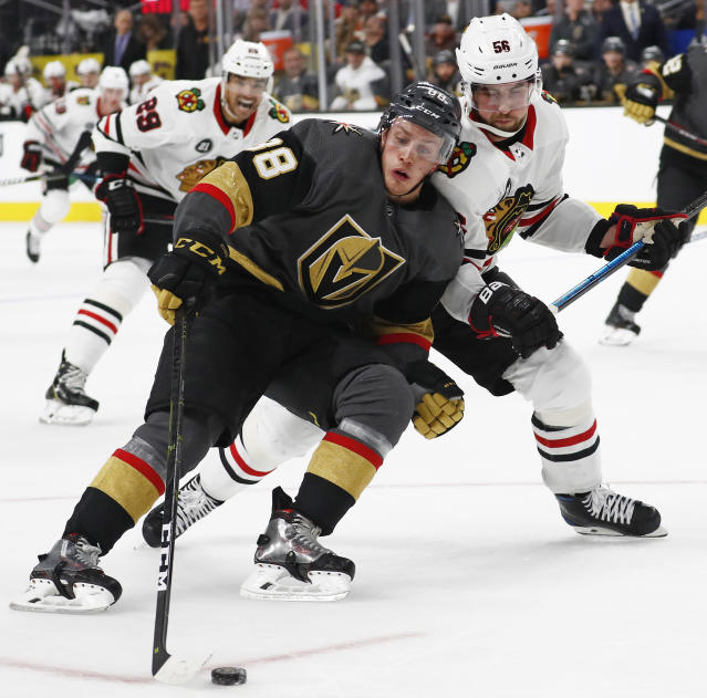 Vegas Golden Knights defenseman Nate Schmidt (88) skates around Chicago Blackhawks defenseman Erik Gustafsson (56) during the second period of an NHL hockey game Thursday, Dec. 6, 2018, in Las Vegas. (AP Photo/John Locher)