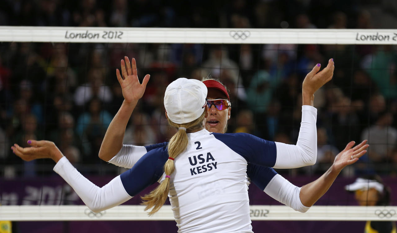 April Ross and Jennifer Kessy of the U.S. celebrate a point against Brazil's Juliana and Larissa during their women's beach volleyball semifinal match at Horse Guards Parade during the London 2012 Olympic Games August 7, 2012.                    REUTERS/Suzanne Plunkett (BRITAIN  - Tags: OLYMPICS SPORT VOLLEYBALL TPX IMAGES OF THE DAY)