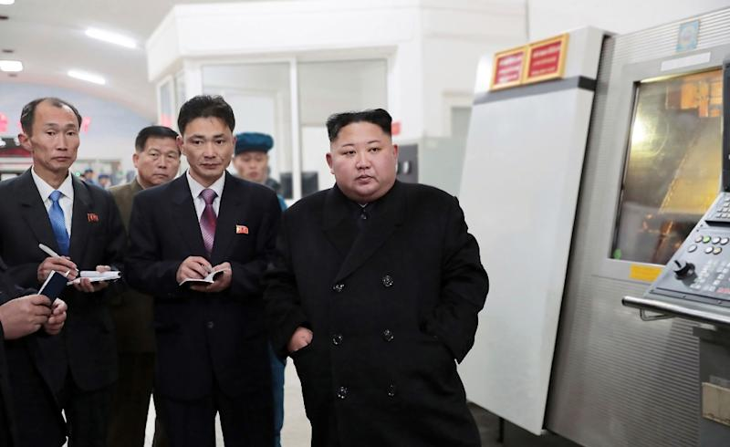 North Korean leader Kim Jong Un (R) is barred under UN sanctions resolutions from sending North Korean workers abroad to earn hard currency