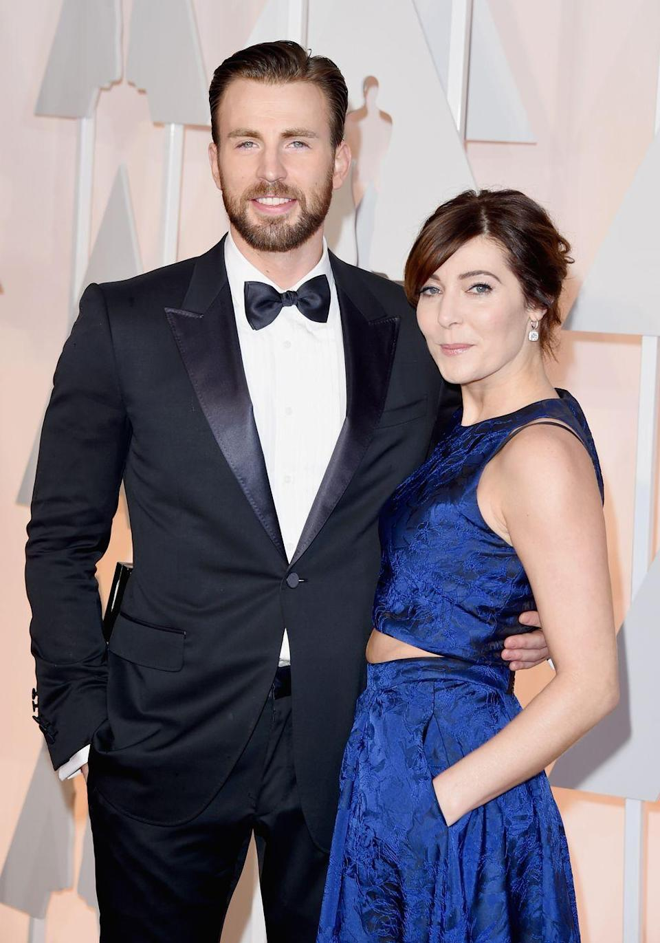 """<p>When Chris Evans walked the 2015 Oscars red carpet with a mystery woman, rumors flew about his relationship status. But during an interview with Robin Roberts, <a href=""""https://www.eonline.com/news/628821/chris-evans-oscars-date-was-his-best-friend-not-his-girlfriend-watch-the-funny-video-clip"""" rel=""""nofollow noopener"""" target=""""_blank"""" data-ylk=""""slk:Chris clarified"""" class=""""link rapid-noclick-resp"""">Chris clarified</a> that his date was none other than childhood best friend Tara Testa. Since then, Tara accompanied Chris and his brother Scott at the <a href=""""https://www.pinterest.com/pin/223983781455041882/?nic_v1=1aKqTPmWhVZvbVZ%2Bh2mx3Wr1tFY%2BTNROPHbNdjCh9Ke1yujYrYuBSiJwCywrgxmPeU"""" rel=""""nofollow noopener"""" target=""""_blank"""" data-ylk=""""slk:2019 Vanity Fair Oscars party"""" class=""""link rapid-noclick-resp"""">2019 <em>Vanity Fair </em>Oscars party</a>. The internet also managed to <a href=""""https://twitter.com/ifcapdiesidie/status/1235703725945057280?lang=en"""" rel=""""nofollow noopener"""" target=""""_blank"""" data-ylk=""""slk:find photos"""" class=""""link rapid-noclick-resp"""">find photos</a> of Chris and Tara's friendship from over the years.</p>"""