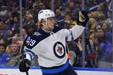 Apr 14, 2019; St. Louis, MO, USA; Winnipeg Jets right wing Patrik Laine (29) celebrates after scoring during the second period in game three of the first round of the 2019 Stanley Cup Playoffs against the St. Louis Blues at Enterprise Center. Mandatory Credit: Jeff Curry-USA TODAY Sports