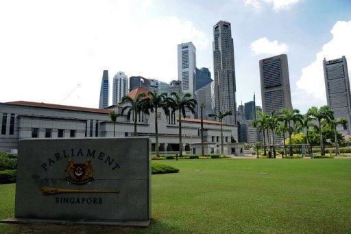 A view of the Parliament House compound in Singapore. Singapore is to slash its leaders' unpopular multi-million-dollar salaries by at least a third, but they will remain the world's best-paid politicians