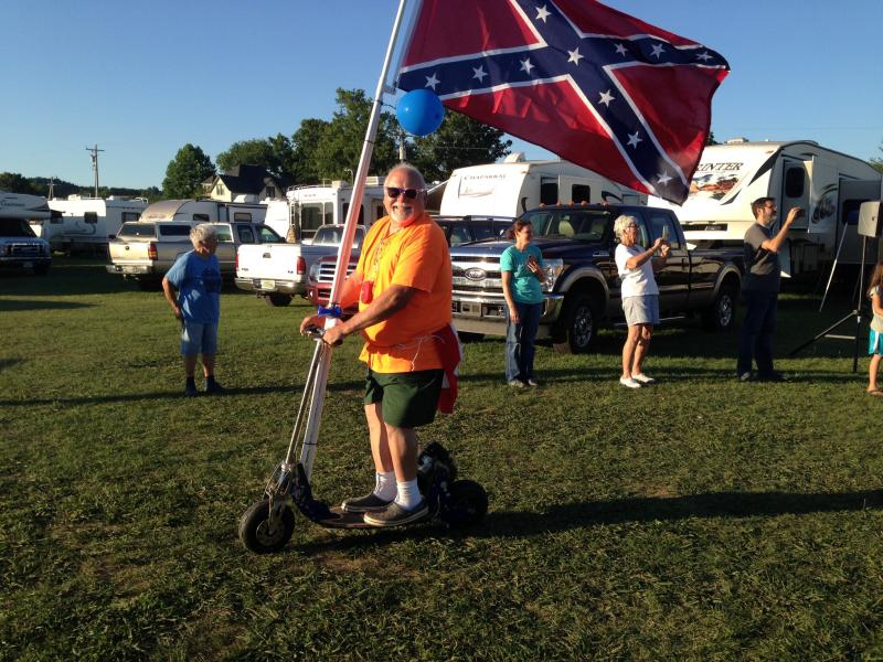 A photo of a man proudly parading the Confederate flag at a Diana Singing event has come under fire. (Credit: Madison Laird)