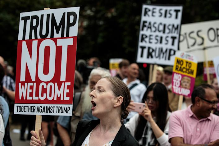 <p>Protesters chant and wave placards during a demonstration outside Winfield House, the London residence of U.S. Ambassador Woody Johnson, where President Donald Trump and first lady Melania Trump are staying tonight on July 12, 2018 in London, Britain. (Photo: Jack Taylor/Getty Images) </p>