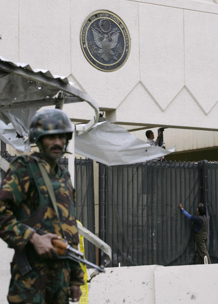 FILE - In this Thursday, Sept. 18, 2008 file photo, a Yemeni soldier stands guard in front of the main entrance of the U.S. Embassy in Sanaa, Yemen. After years of stalling under its now-ousted leader, Yemen is finally showing resolve in the fight against al-Qaida, aided by the United States, which just scored an intelligence coup by breaking up a new bomb plot there. (AP Photo/Nasser Nasser, File)